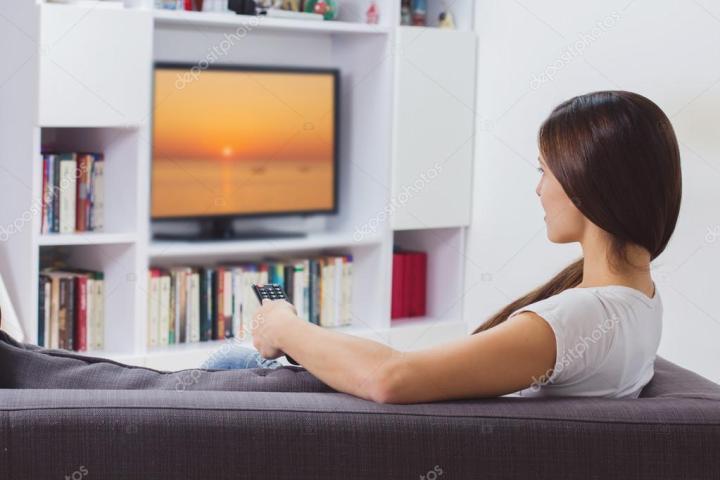 depositphotos_94421790-stock-photo-woman-watching-tv-at-home
